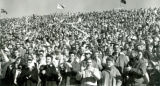 Fans waving streamers at Homecoming football game, 1959