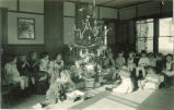 Children gathered around the Christmas tree, The University of Iowa, 1920s