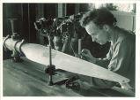 Engineering student working on propeller blade, The University of Iowa, 1950s