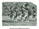 Scottish Highlanders performing at football game, The University of Iowa, November 11, 1939