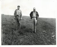 Unidentified men walking in a field
