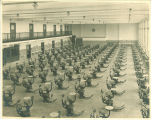 Clinic room full of exam chairs from a balcony at Trowbridge Hall, The University of Iowa, between 1917 and 1920