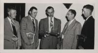 Awarding Soil Conservation Achievement Plaques.