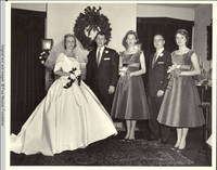 Frindy, John, Sr., Vidie, Groomsman and Betsy in living room posing for pictures