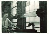 Student manipulating equipment in Hydraulics laboratory, The University of Iowa, 1930s