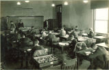 Geology classroom with students working at desks, The University of Iowa, 1920s