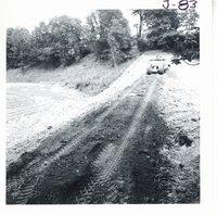 Building earth dam on William Wise farm, 1968