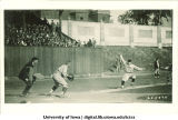 Iowa baseball player trying to steal home base, The University of Iowa, 1920s
