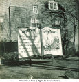 Fraternity house with Homecoming sign, The University of Iowa, November 1940