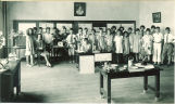 Students posed with teacher for school open house, The University of Iowa, June 1926