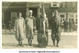 Students in clown costume, Mecca Day, The University of Iowa, 1919