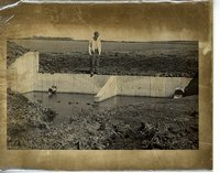 Man standing on a water control structure