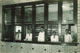 Pharmacy students gazing out windows of pharmacy laboratory, The University of Iowa, 1920s