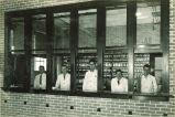 Pharmacy students gazing out windows of pharmacy laboratory, The University of Iowa, 1920s