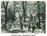 Volleyball game at a picnic, The University of Iowa, late 1930s