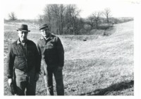 Henry Deppe and Robert Deppe standing before waterway