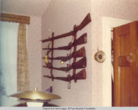 View of gun rack with rifles and powder horn