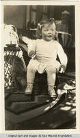 Vidie seated on little chair