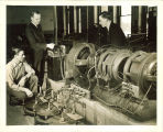 Engineering students with large turbine in engineering laboratory, The University of Iowa, 1939