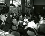Alumni seated at tables in the Memorial Union for the Homecoming Banquet, 1969