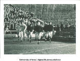 Football players in Iowa-Notre Dame game at Kinnick Stadium, The University of Iowa, November 11, 1939