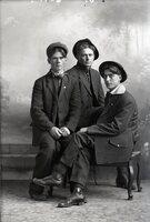 Three men seated
