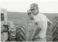 1979 - Two farmers between tractors