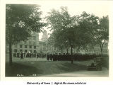 Marching band and commencement procession on west side of Pentacrest, The University of Iowa, June 1929