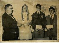 Young woman receiving award