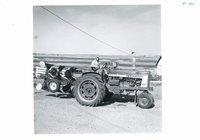 Donald Gray driving new 2-way plow, 1966