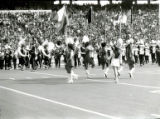 ISU Color Guard performing with the Marching Band for Homecoming, 1977
