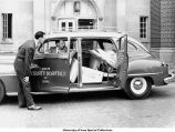 Hospital administrators examine an ambulance, The University of Iowa, 1948