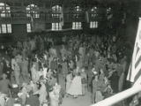Milling crowd in State gym after football game, 1952
