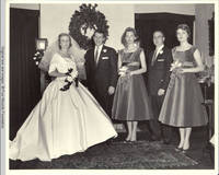 Frindy, John, Sr., Vidie, Groomsman and Betsy in living room by fireplace <br /> <br />