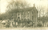 Carriages in front of St. Nicholas Hotel, Mason City, Ill.,  1900s