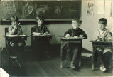 Children seated at desks in classroom, The University of Iowa, 1920s