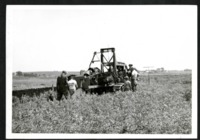 Men Work on a Dozer in a Field