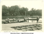 Students launching canoe in tandem, The University of Iowa, 1920s