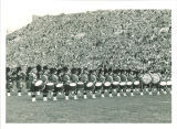 University of Iowa Scottish Highlanders performance at football game, 1950s?