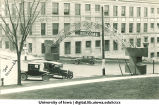 Homecoming arch on Washington Street next to Engineering Building, The University of Iowa, 1930s