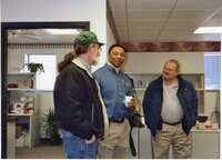 2003 - Gerald Fosdick, NRCS District Conservationist Terrance Rudolph, and Extension Director Don Buzzingham chat in the office