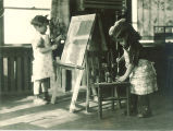 Girls painting at easels, The University of Iowa, 1920s