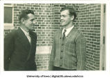 Glenn Devine, assistant athletic director, with high school athlete, The University of Iowa, June 7, 1937