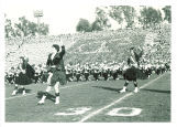 Scottish Highlanders and University of Iowa marching band performing at Rose Bowl, Pasadena, Calif., January 1957