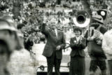 President Parks waving at Homecoming, 1985