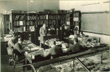 Geology classroom with students working at desks with rocks, The University of Iowa, 1920s