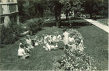 First-grade students feeding ducks, The University of Iowa, May 15, 1930