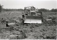 1995 - Construction of Ditch Crossing with bulldozer and pipe.