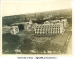 Commencement in front of MacLean Hall on the Pentacrest, with Jessup Hall to the left and the Old Capitol in background, The University of Iowa, 1910s