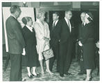 "Paul Engle and others at reception for Iowa Writers' Workshop anthology ""Midland,"" Iowa Memorial Union, The University of Iowa, 1961"